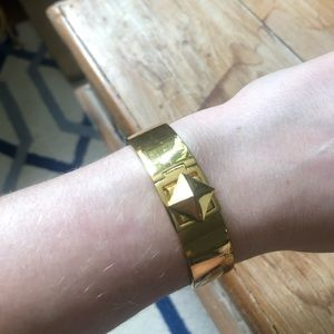 Thick Kate Spade gold pyramid bangle bracelet